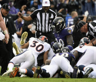 Penalties doom Broncos in loss against Baltimore
